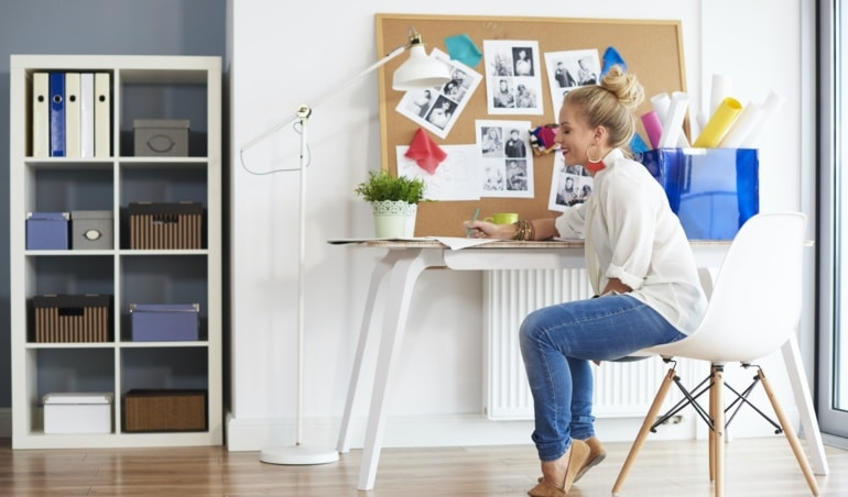 Fashionable woman creating at home interior